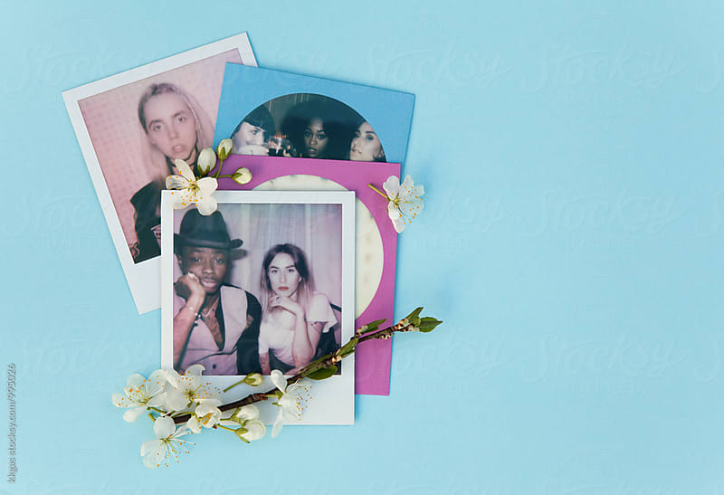 Polaroid print of best friends on a blue background with white flowers by kkgas for Stocksy United