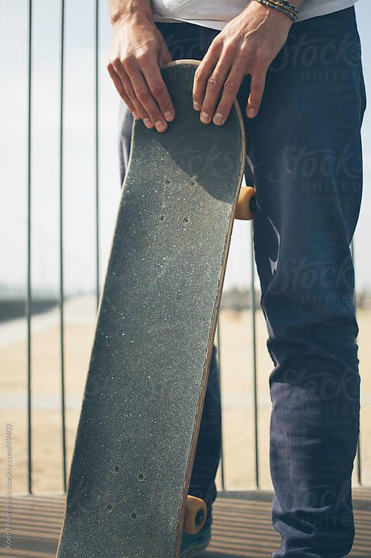 Skater holding his skateboard on a ramp. by Koen Meershoek for Stocksy United