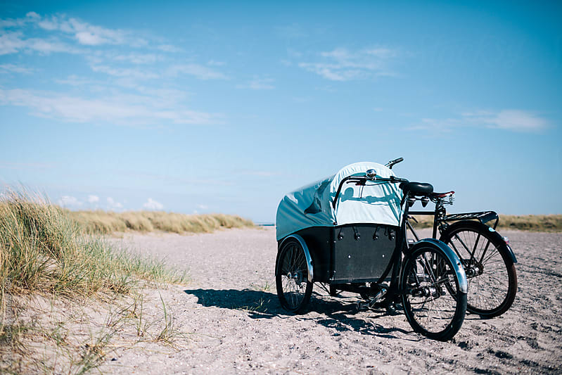 Two bicycles on beach by Zocky for Stocksy United