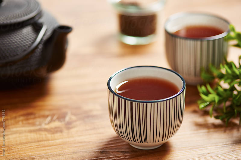 Tea on a tea cup by Martí Sans for Stocksy United