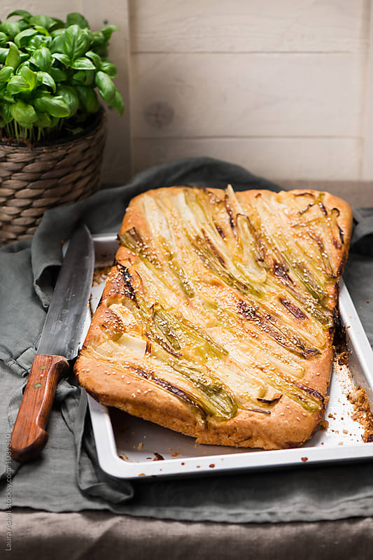 Wholemeal focaccia with green onions by Laura Adani for Stocksy United