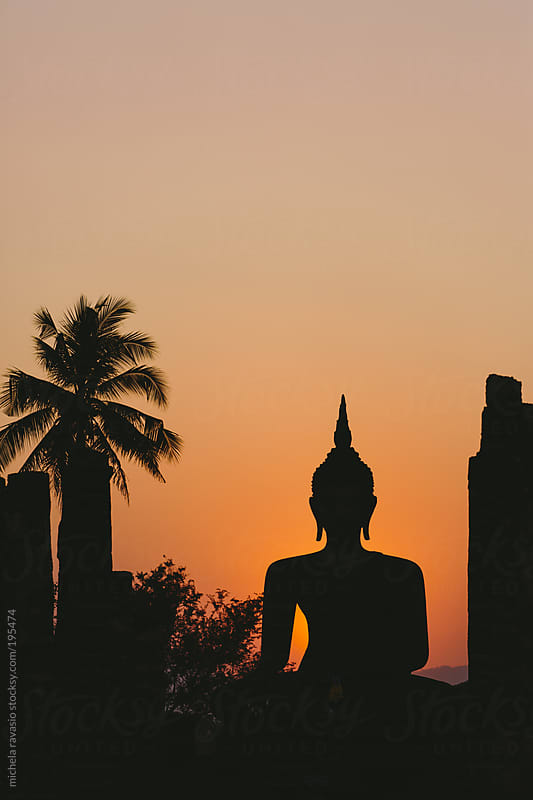 Buddha statue at sunset by michela ravasio for Stocksy United