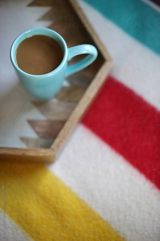 A Cup Of Coffee On A Tray With A Wool Blanket by ALICIA BOCK for Stocksy United