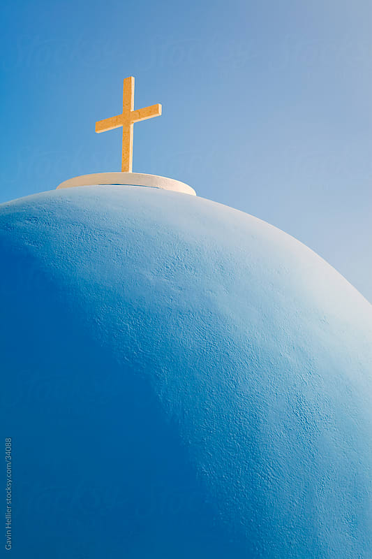 Church with blue dome overlooking the Aegean, Fira, Thira, Santorini, Cyclades, Greek Islands, Greece, Europe by Gavin Hellier for Stocksy United