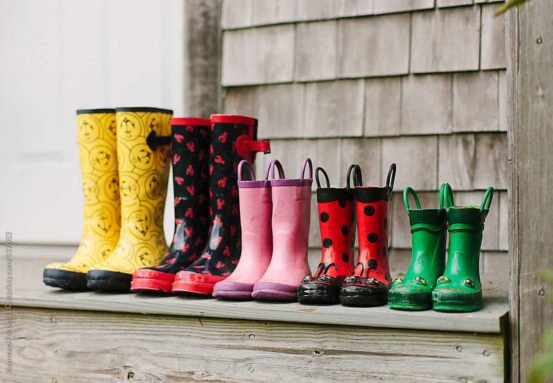 Boots arrangement on Porch by Raymond Forbes LLC for Stocksy United