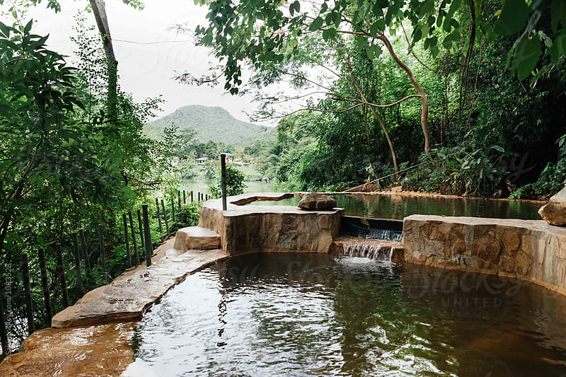 natural water pool  by jira Saki for Stocksy United