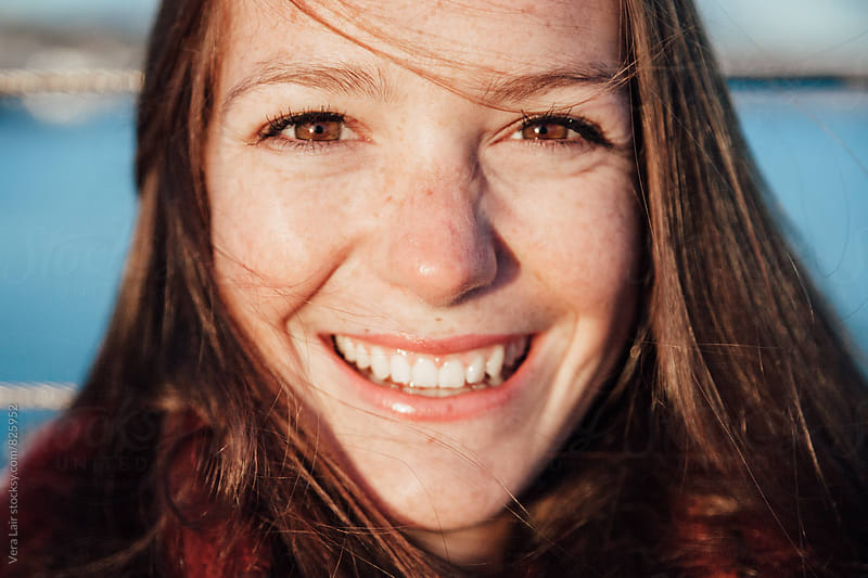 Beautiful smiling woman with freckles by Vera Lair for Stocksy United