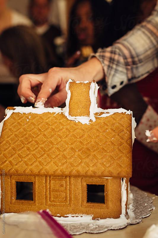 Building gingerbread houses by Gabriel (Gabi) Bucataru for Stocksy United