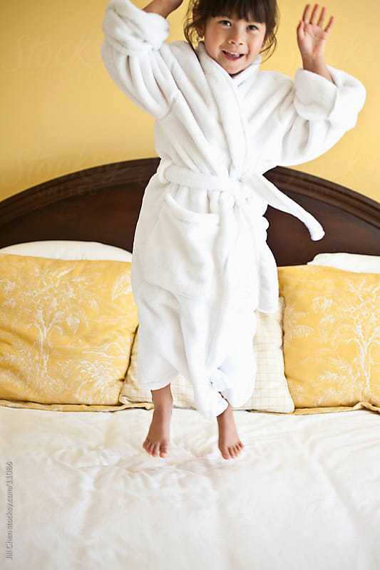 Jumping on Bed by Jill Chen for Stocksy United