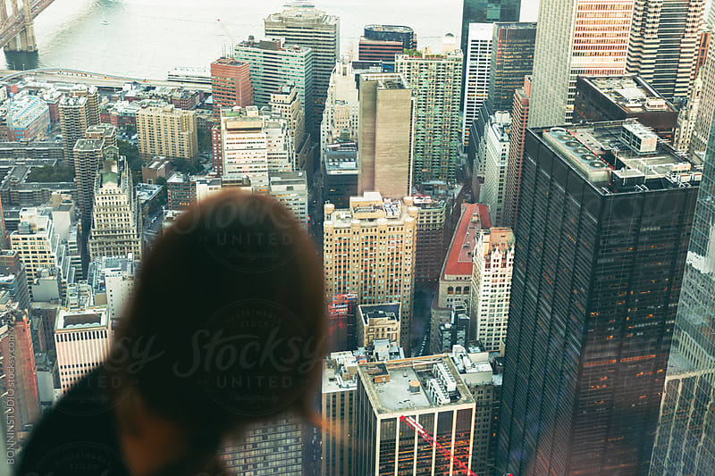Back view of a woman looking the lower Manhattan skyline views. by BONNINSTUDIO for Stocksy United