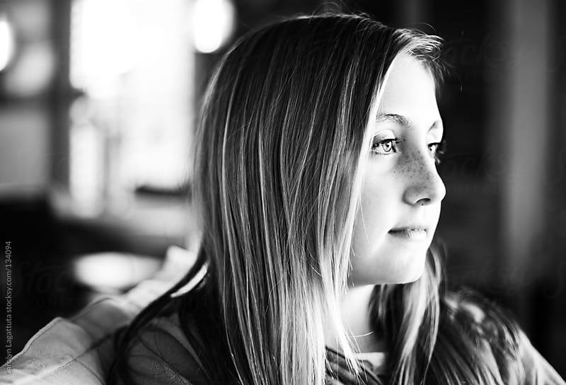 Profile of a beautiful teen girl by Carolyn Lagattuta for Stocksy United
