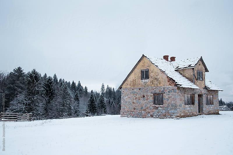 Old Mountain House in the Wintertime by Branislav Jovanović for Stocksy United
