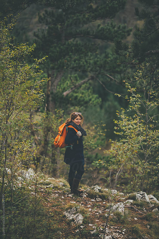 Woman With a Backpack Standing in Nature by Lumina for Stocksy United
