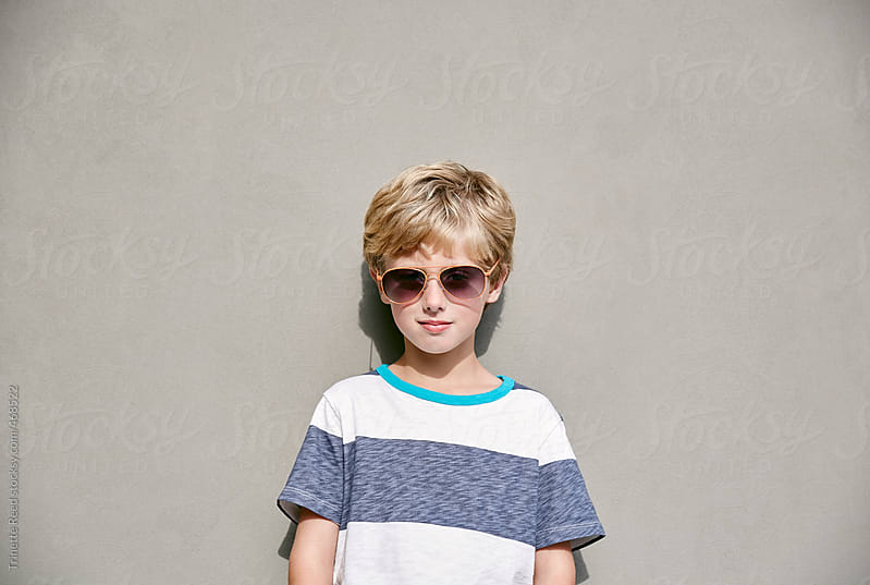 Portrait of stylish young boy by Trinette Reed for Stocksy United