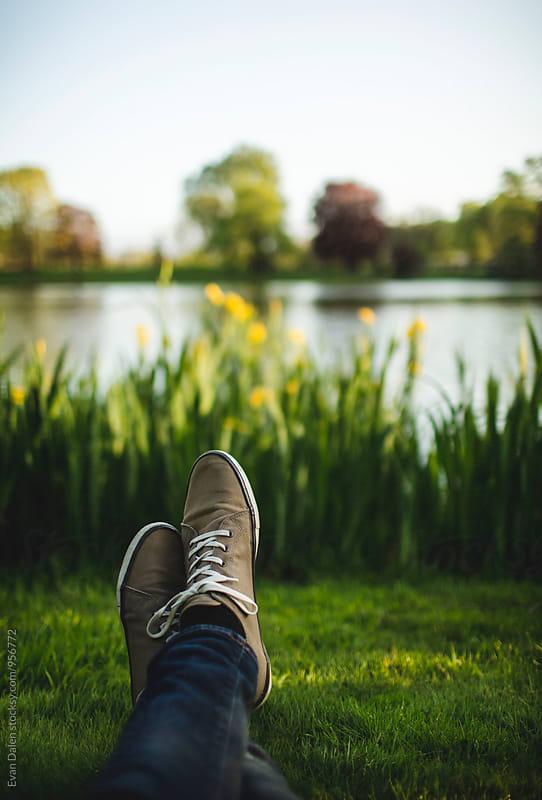 Crossed Legs by Lake by Evan Dalen for Stocksy United