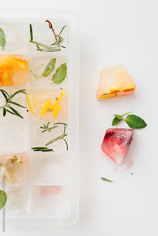 Ice Cubes With Frozen Fruit by Katarina Radovic for Stocksy United