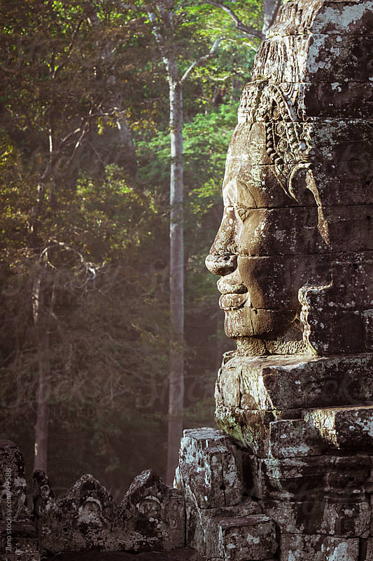 Carved buddha head at Bayan temple Angkor Wat by Micky Wiswedel for Stocksy United