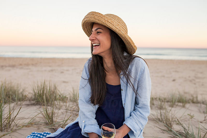 Beautiful woman laughs and smiles on Sussex Inlet beach at sunset by Reece McMillan for Stocksy United