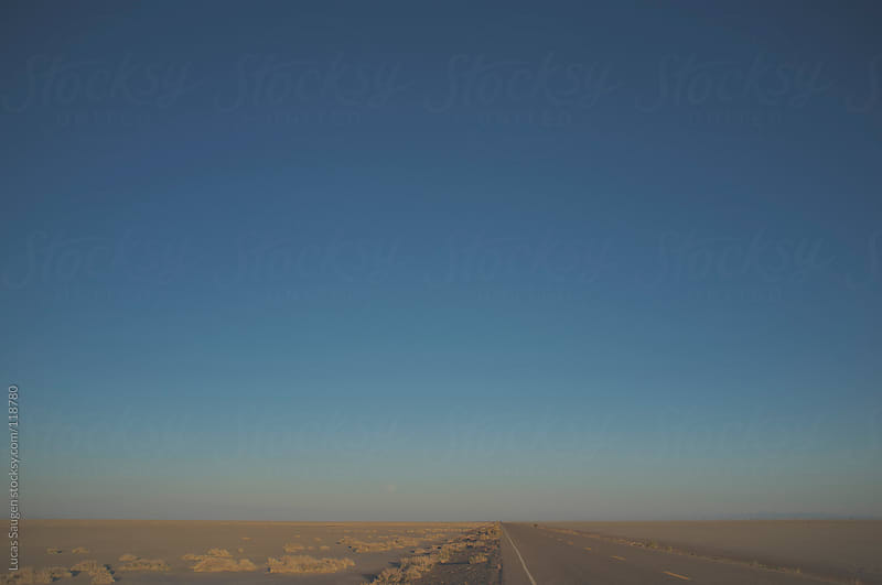 Road in the Salt Flats. by Lucas Saugen for Stocksy United