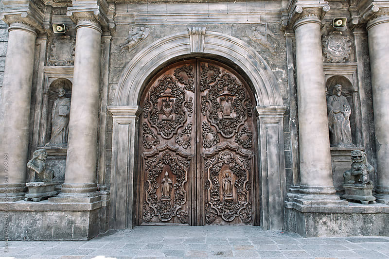 Intricate details on a beautiful wooden church door by Lawrence del Mundo for Stocksy United