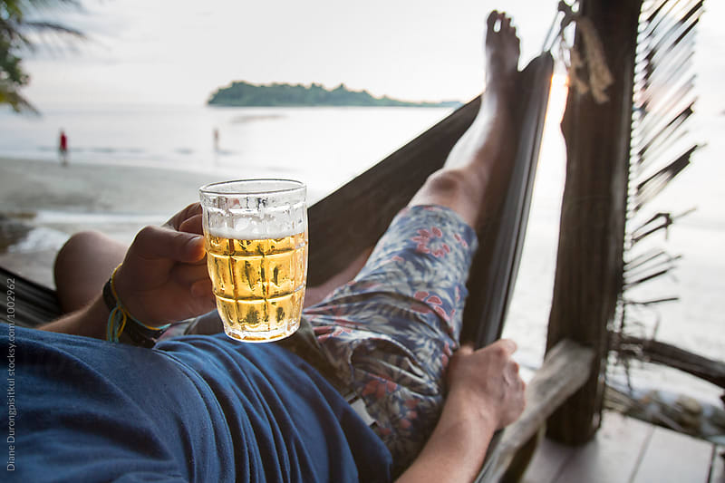 Cold Beer in Hammock by Diane Durongpisitkul for Stocksy United