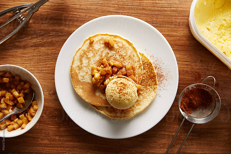 Vanilla ice-cream and cinnamon pancakes by Martí Sans for Stocksy United