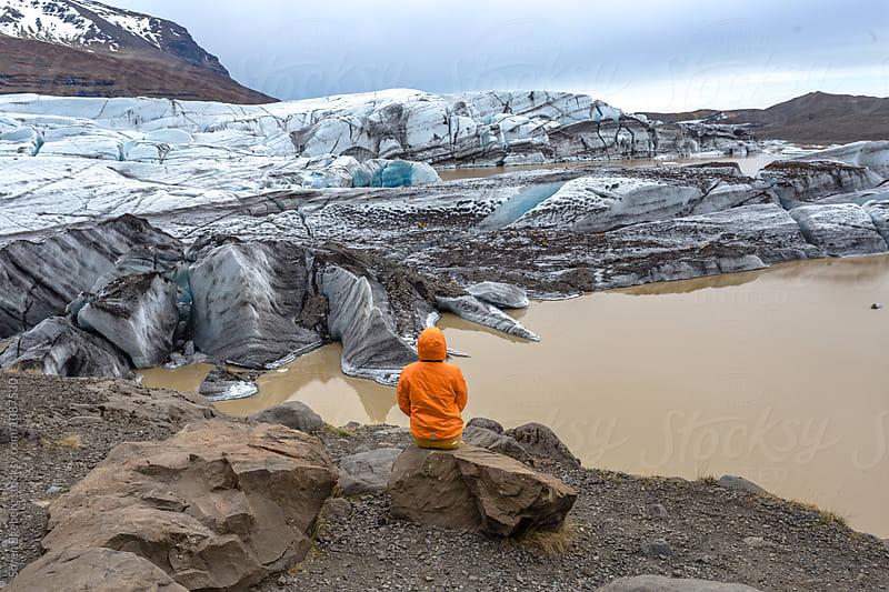 Woman enjoying view of glacier landsape in Iceland by Søren Egeberg Photography for Stocksy United
