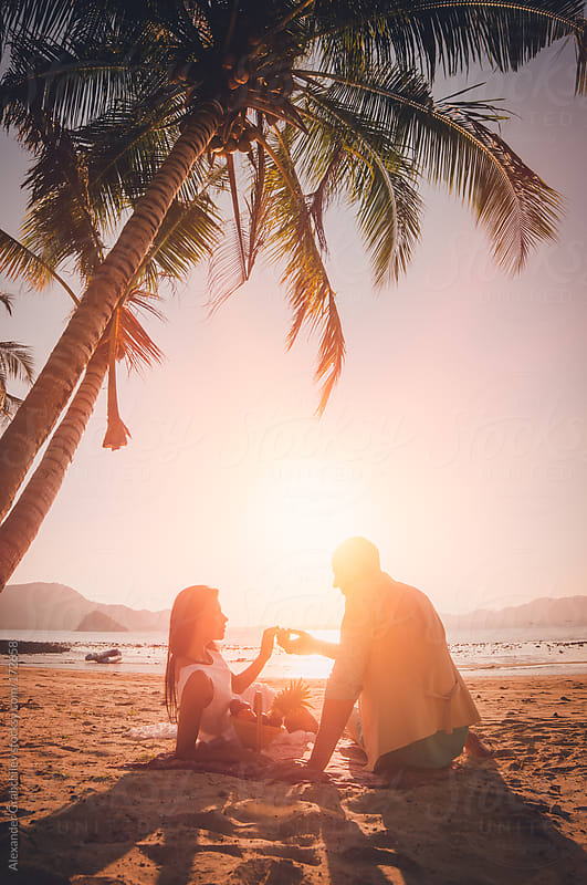 Honeymoon Couple  In Love At  Tropical Sunset Beach  by Alexander Grabchilev for Stocksy United