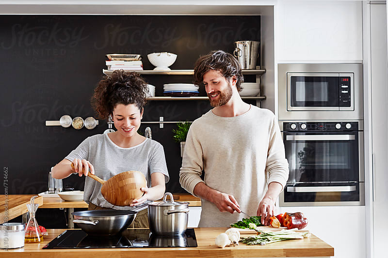 Couple Cooking Together In Kitchen by ALTO IMAGES for Stocksy United