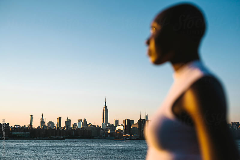 Woman portrait against NY skyline by GIC for Stocksy United