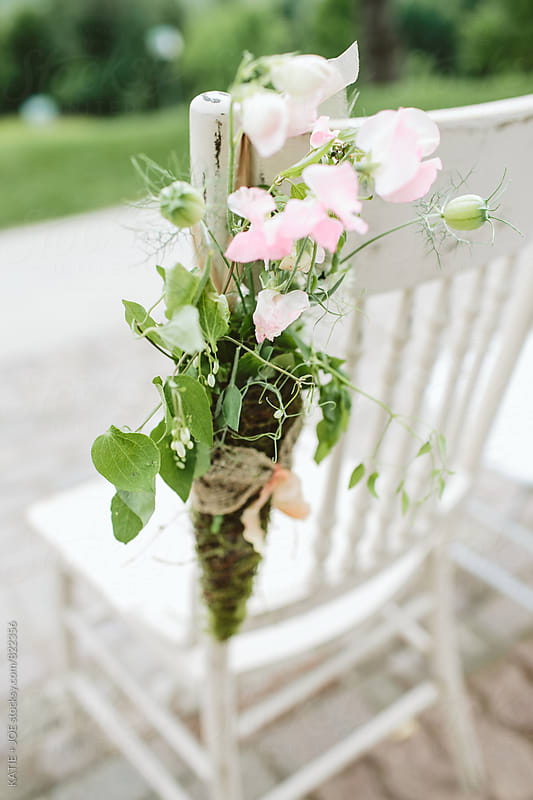 Flowers on a White Chair by KATIE + JOE for Stocksy United