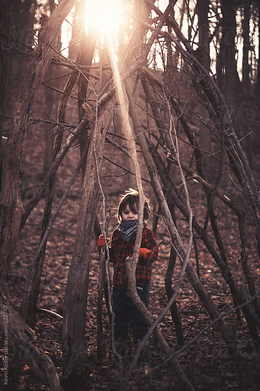 Young Boy Standing Outside in a Tree Fort by Kevin Keller for Stocksy United