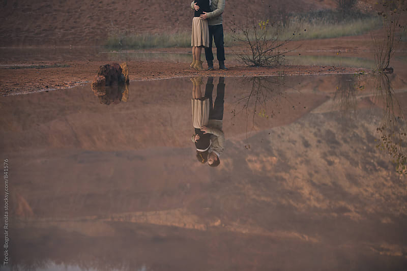 Reflection of a lovely couple at the mountains by Török-Bognár Renáta for Stocksy United
