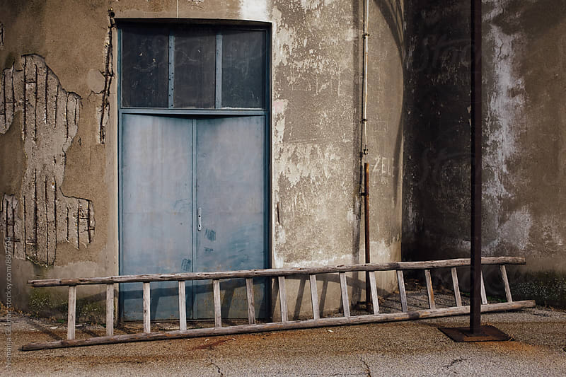 Old Ladders In Front of the Abandoned Factory  by Nemanja Glumac for Stocksy United