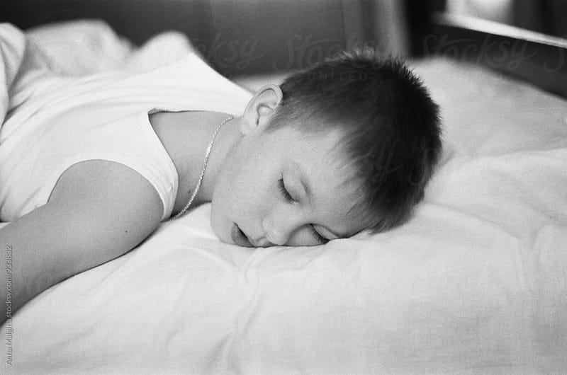 A portrait of sleeping child by Anna Malgina for Stocksy United