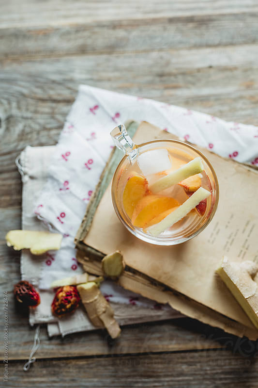 Cold water with peach and ginger by Tatjana Ristanic for Stocksy United