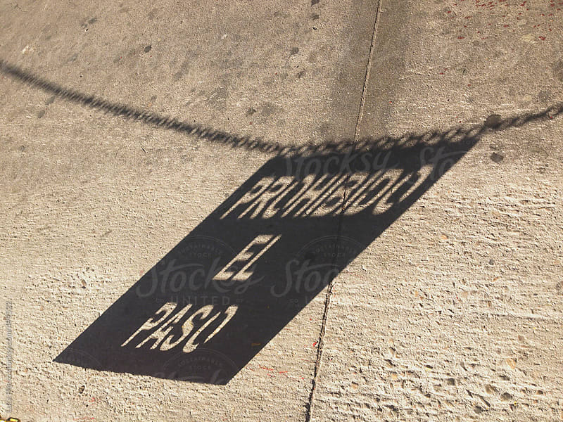 Shadow of closed road sign by Luca Pierro for Stocksy United