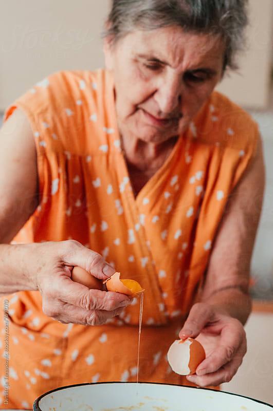 Senior woman in the kitchen by Dimitrije Tanaskovic for Stocksy United