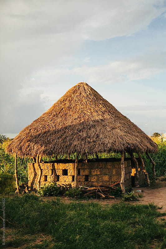 African Hut as the Sun Sets by B. Harvey for Stocksy United