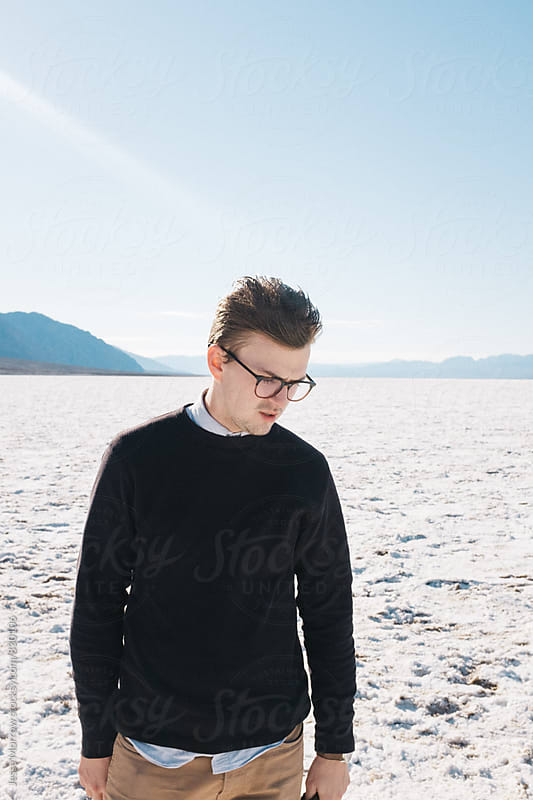 portrait of young male outdoors in salt flat bad water basin by Jesse Morrow for Stocksy United