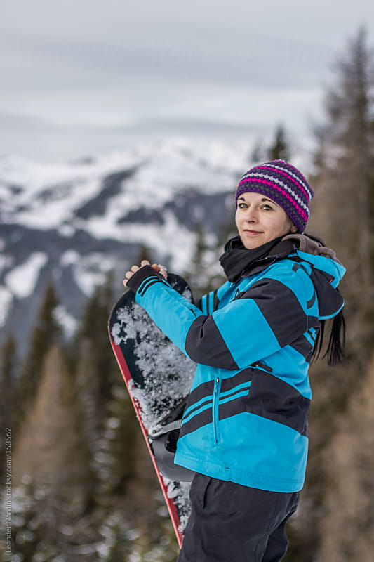 portrait of a female Snowboarder by Leander Nardin for Stocksy United