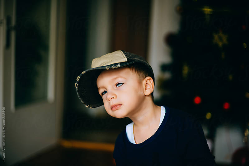 Boy is plaing with the cap by Jovana Vukotic for Stocksy United