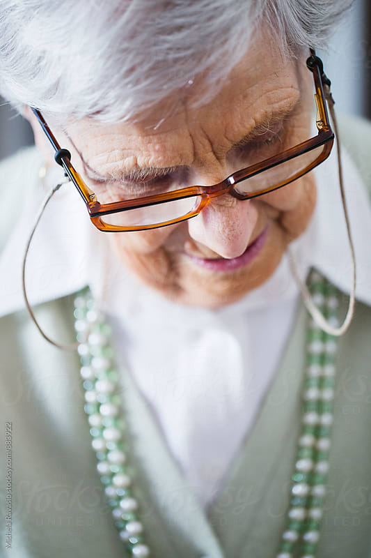 Elderly woman with eyeglasses by michela ravasio for Stocksy United