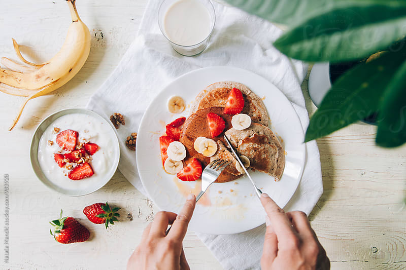 Homemade pancakes with strawberries and banana by Nataša Mandić for Stocksy United