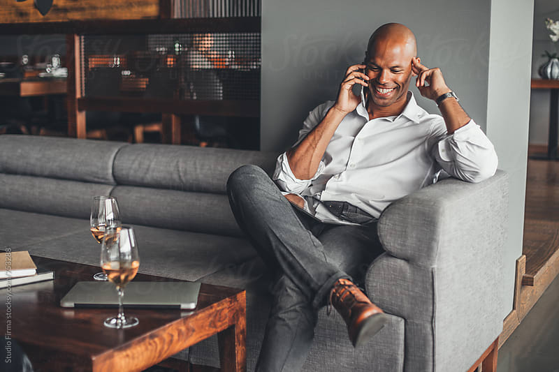 Businessman Talking on the Phone by Studio Firma for Stocksy United