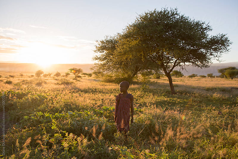Maasai Boy in Field by Diane Durongpisitkul for Stocksy United
