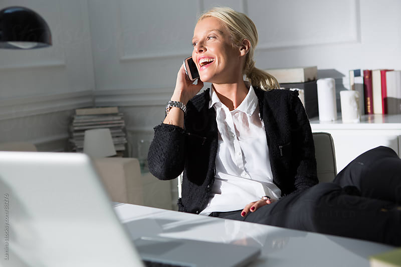 Smiling Caucasian Businesswoman Telephoning  by Lumina for Stocksy United