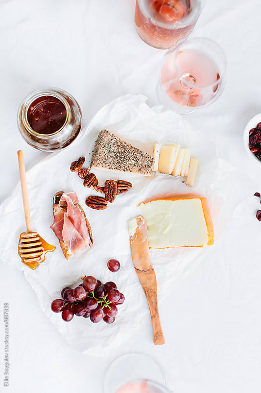 Cheeseboard with wine by Ellie Baygulov for Stocksy United