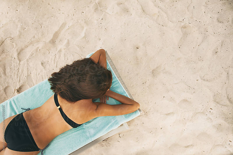 Tropical: Overhead View Of Woman On Beach Sleeping by Sean Locke for Stocksy United