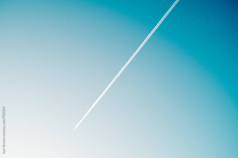 Plane trail by Sam Burton for Stocksy United